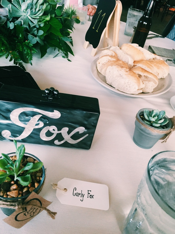 Rustic chic table scape with take home succulents. Custom bag by Edie Parker.